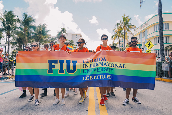 LGBT students holding the FIU sign at the Pride parade in South Beach