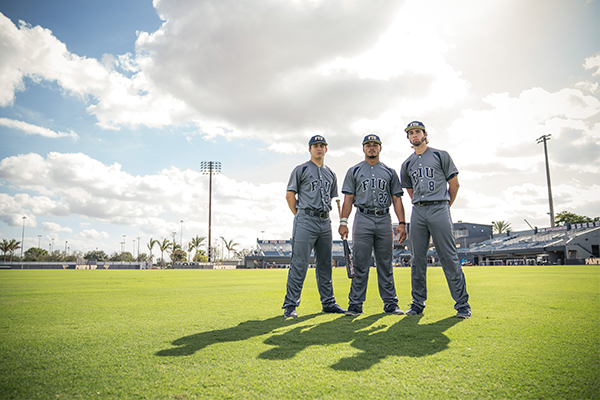 Three baseball players posing for a portrait.